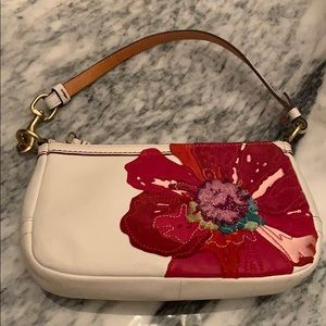 Coach leather clutch with Flower design